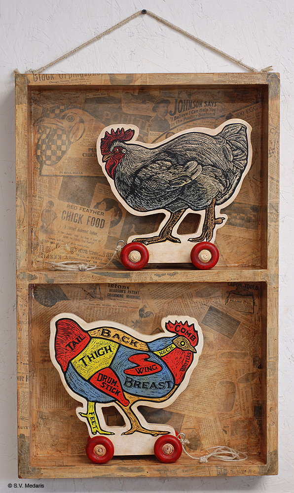 box holds 2 antique-looking chicken pulltoys
