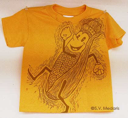 Corn King character by S.V. Medaris on child's XS t-shirt