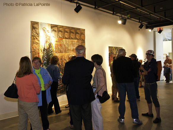 people in front of artwork in gallery