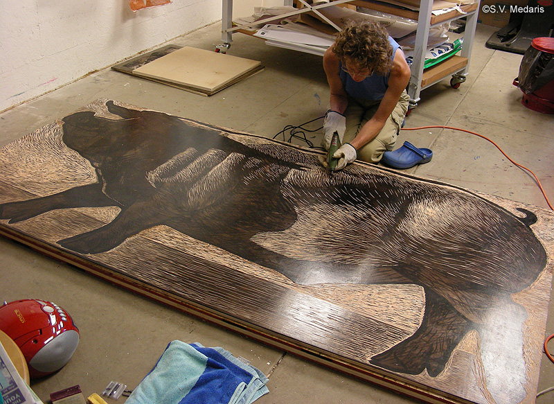Sue Medaris carves a 4x8ft sheet of plywood