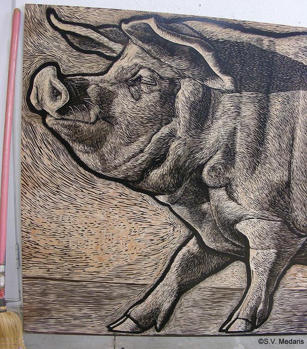 close-up of face of 4x8ft woodcut block