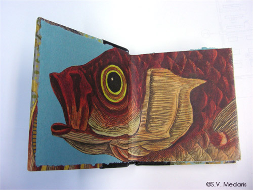 vintage illustrated fish decorates end papers of leather-bound book