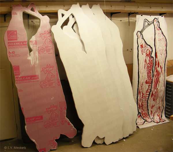 8ft carcass prints hang next to foam shapes