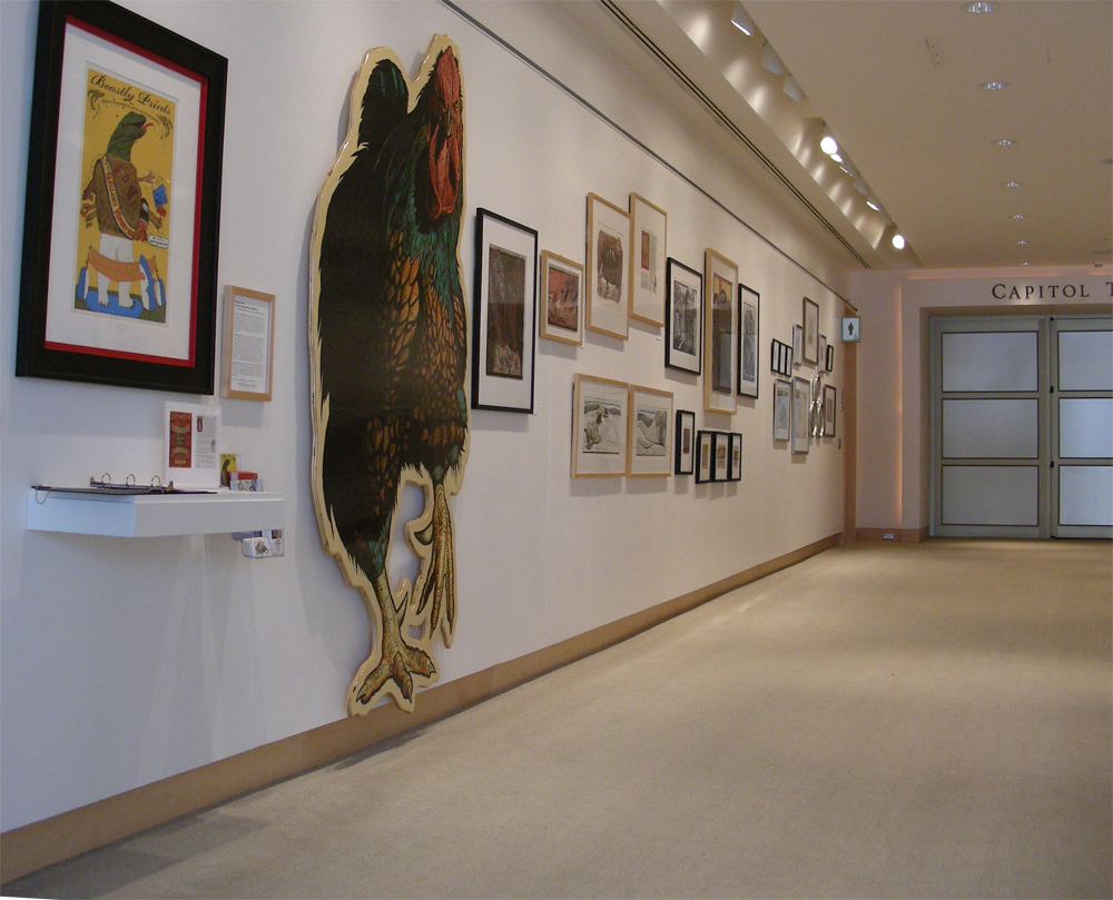 framed art on wall, with 8ft woodcut chicken in foreground