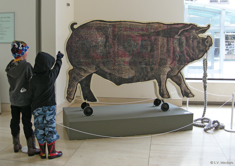 woodcut printed 8ft pulltoy pig with kids
