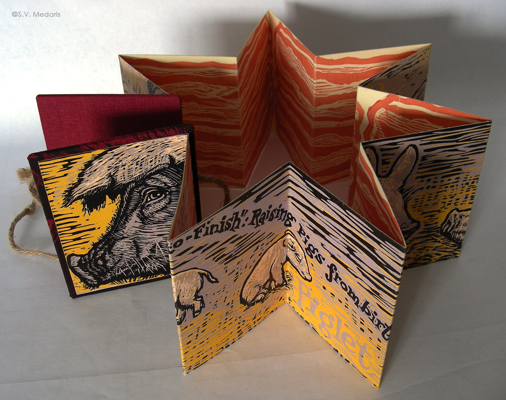 accordion book folded backwards into star shape