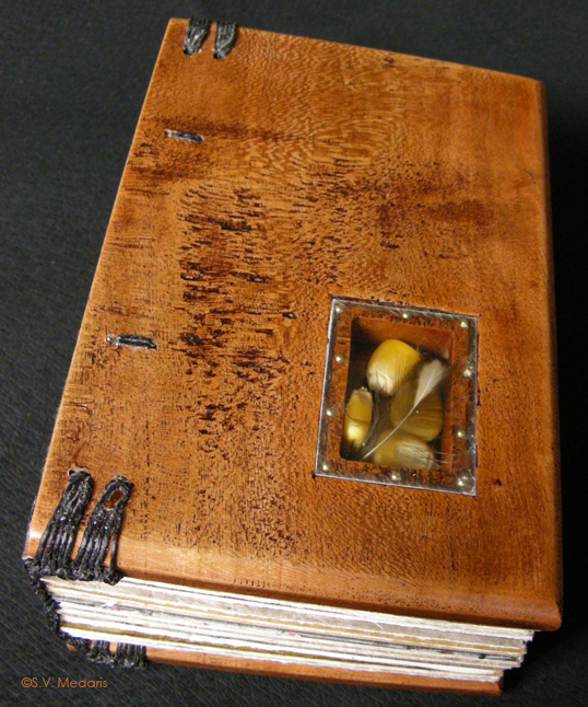 wooden covered book