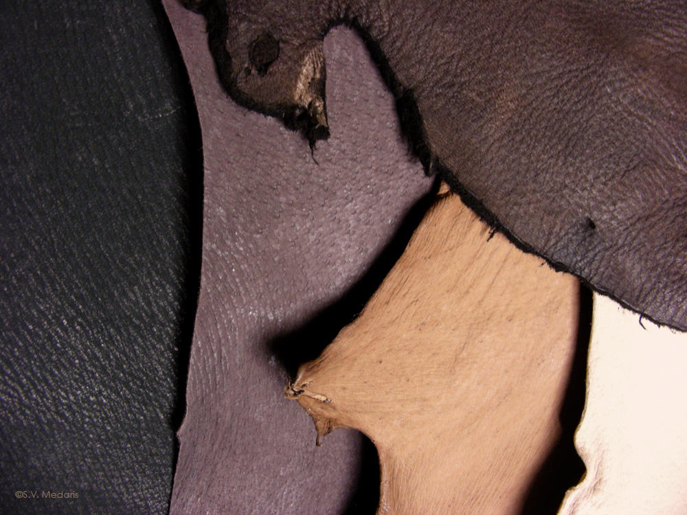 black, brown and natural colored hog hides and bucksin