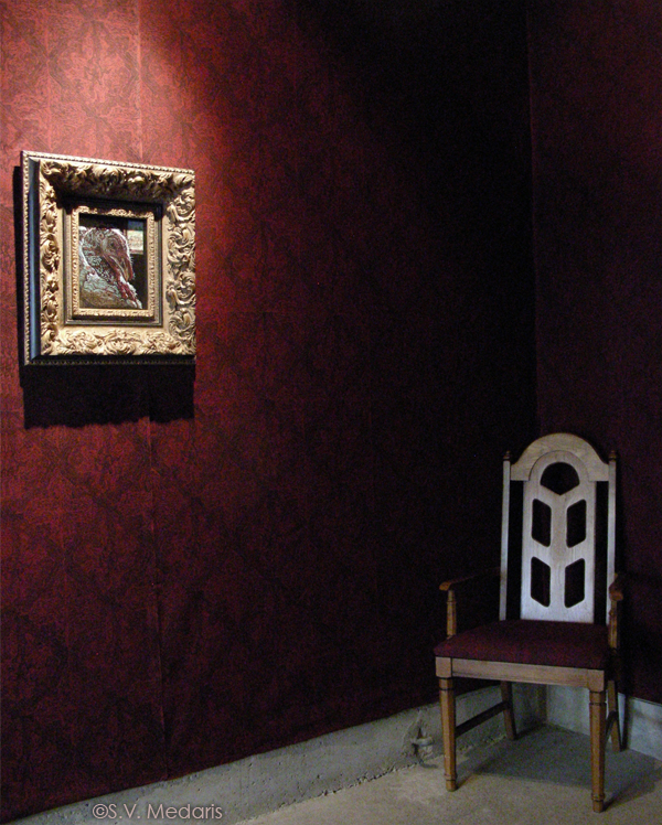 ornate wallpaper, fancy-framed portraits