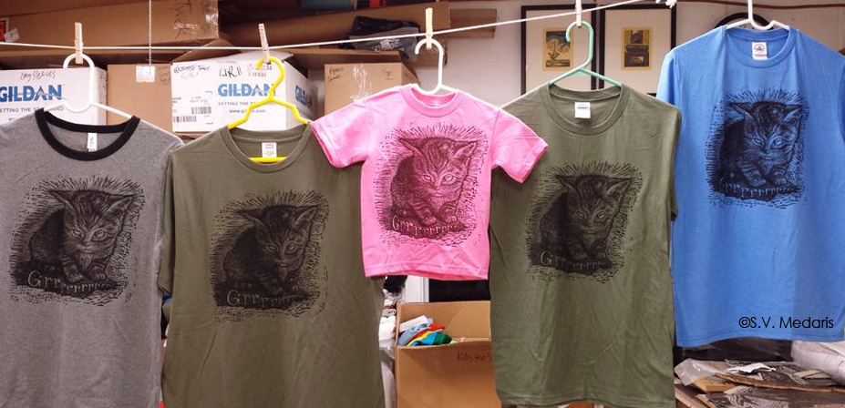 fierce kitten linocut printed on a variety of colored tees