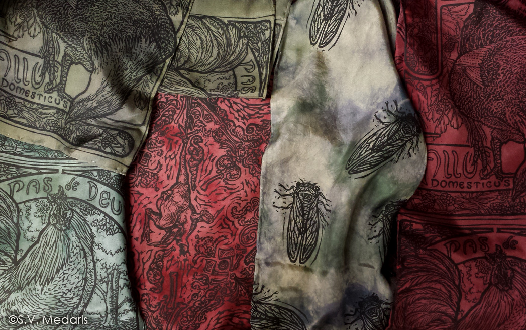 intricately patterned red and green scarves feature insects, chickens and other decorative motifs