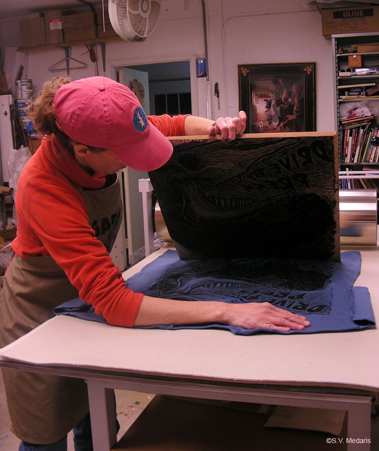 lifting woodcut block off of t-shirt