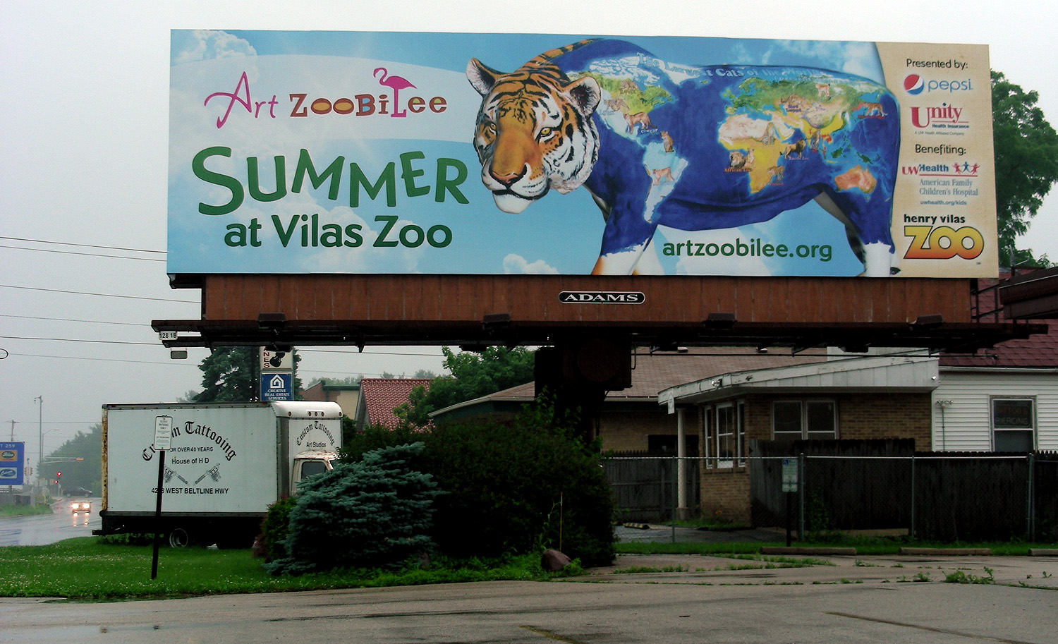 painted tiger (by S.V. Medaris) on billboard advertises the Art Zoobilee