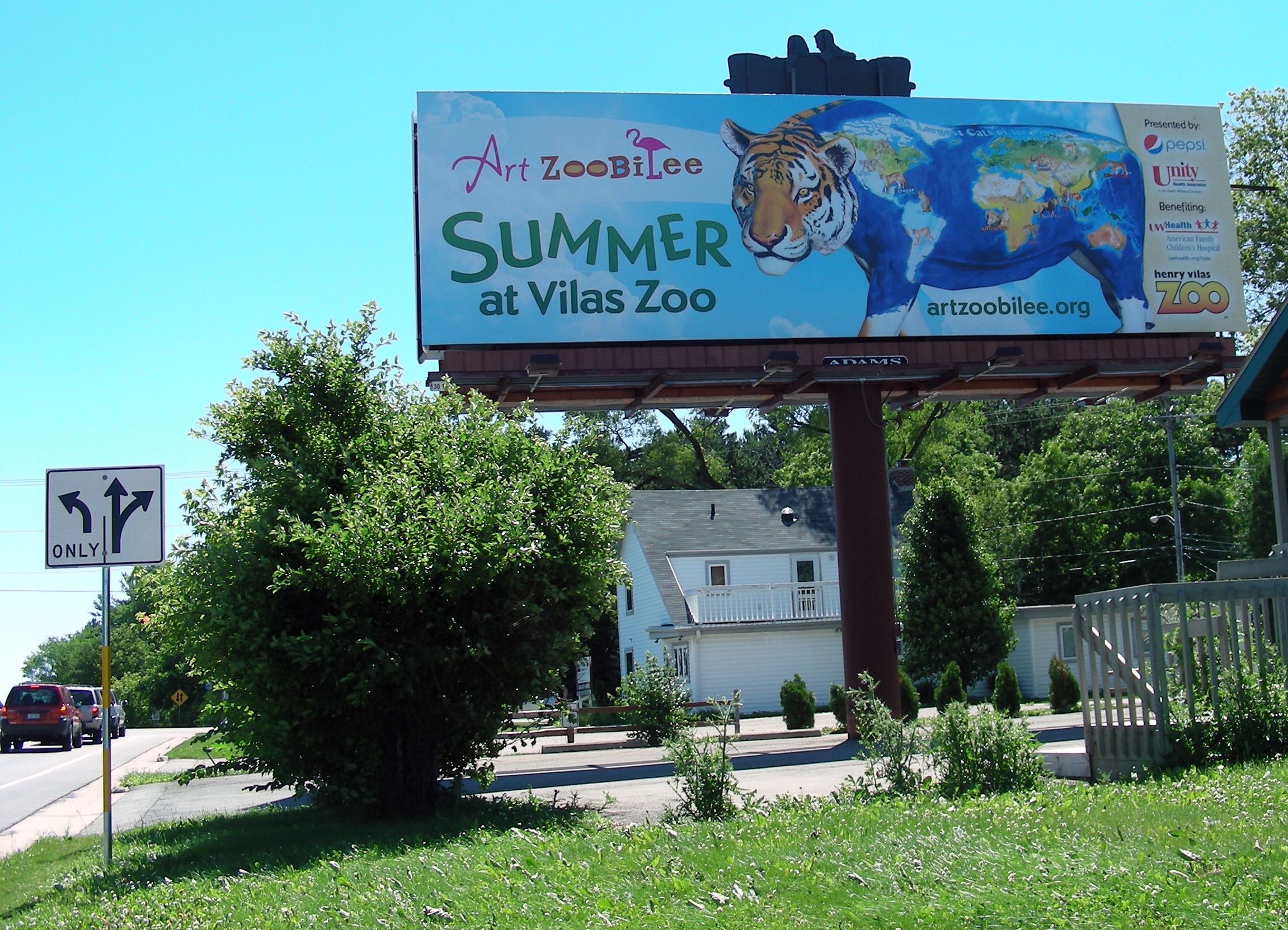 billboard of painted tiger for Art Zoobilee at Vilas Zoo