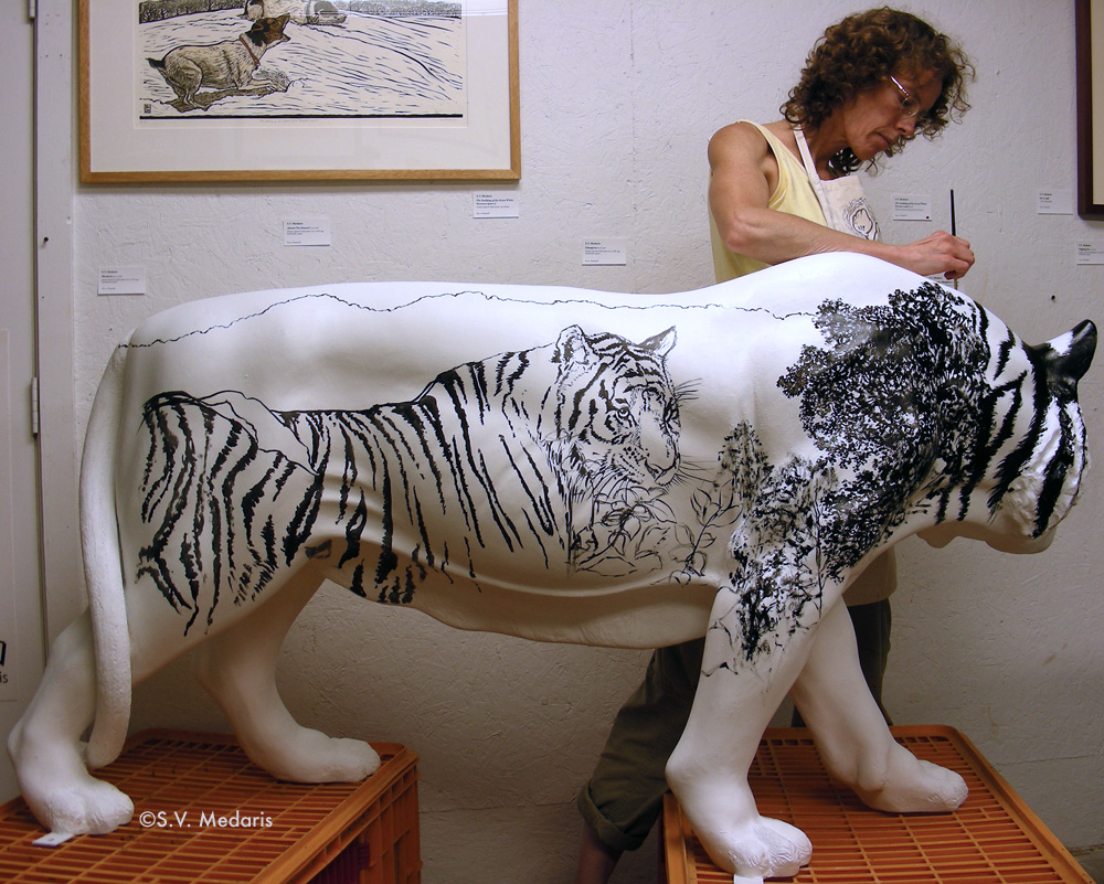 painting of tiger on side of white fiberglass tiger