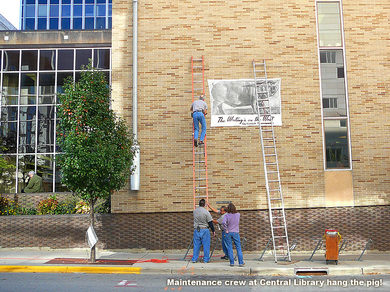 putting up the banner with really tall ladders